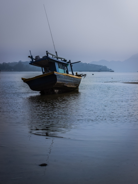 Air pollution drifting in from Indonesia changes the landscape in Rawai Bay, Phuket